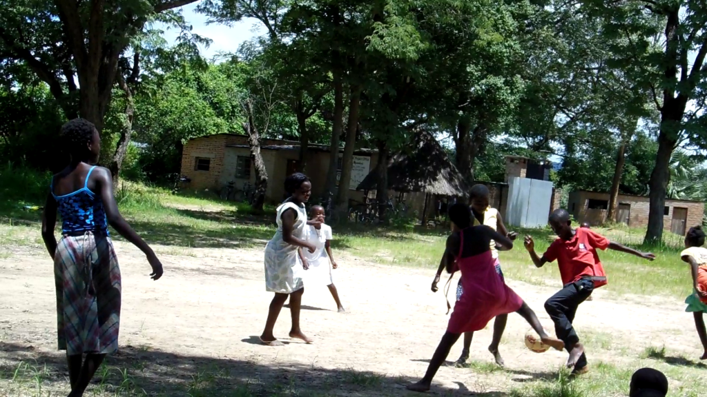 It felt helpless watching two boys get thrown and kicked around a football match by a bunch of girls...in dresses :)