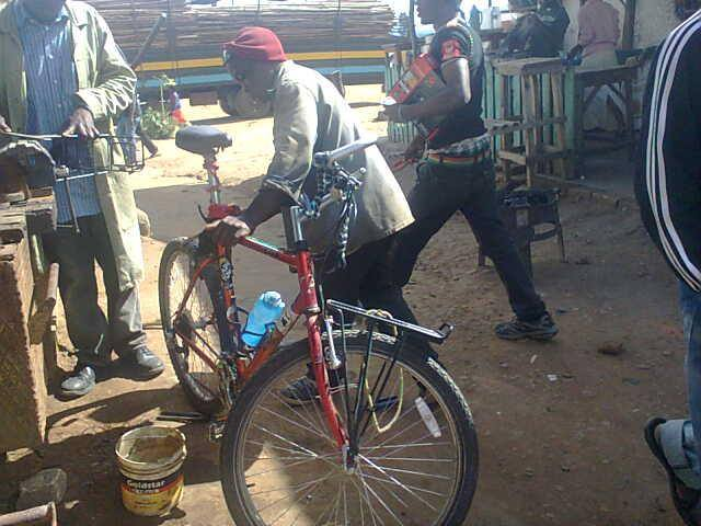 Locals can repair literally anything in Africa: The rear rack being welded back onto the bike once again in lower Tanzania.